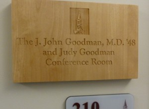 J. John Goodman wooden sign