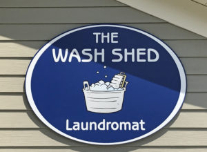 The Wash Shed Laundromat Sign